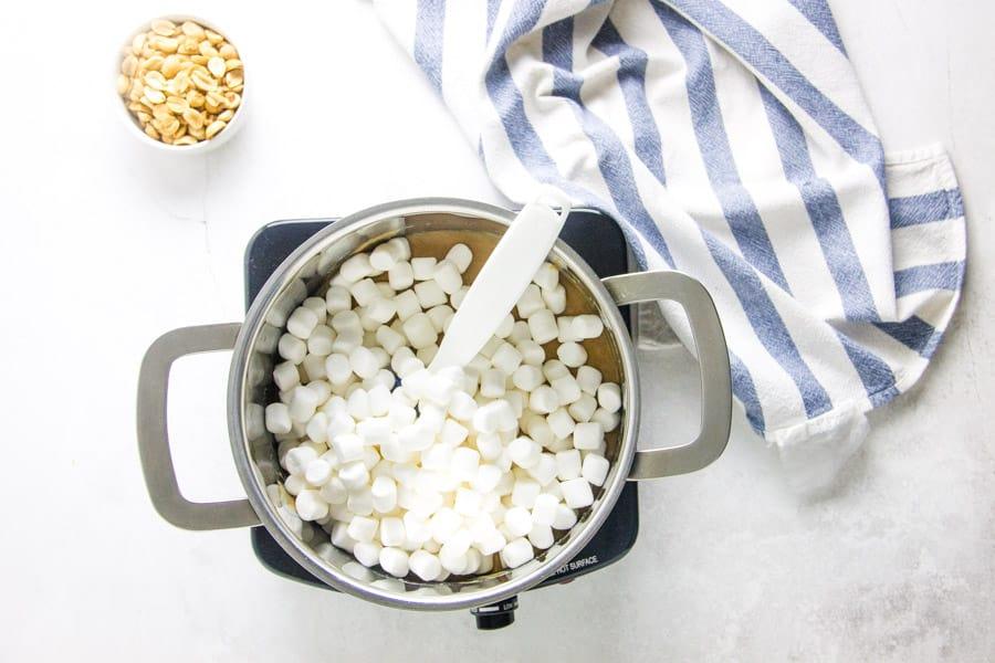 adding in marshmallows to pan