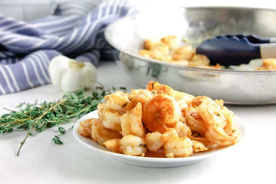 spicy garlic thyme shrimp on white plate