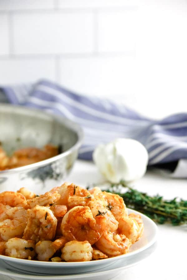 Spicy Garlic Thyme Shrimp on white plate.