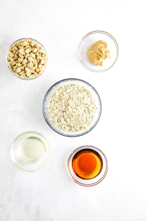 peanut butter granola ingredients in bowls.
