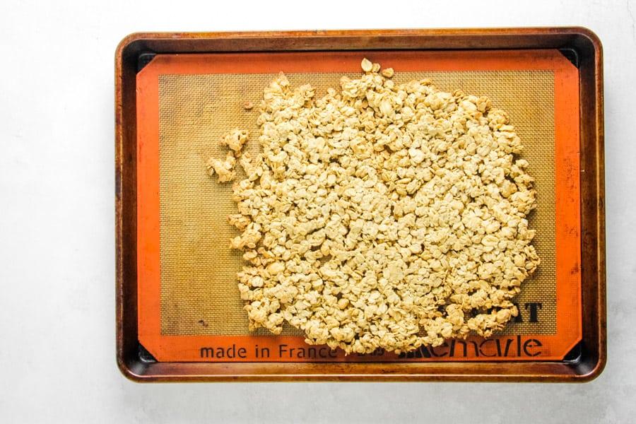 cooked granola on sheet pan.