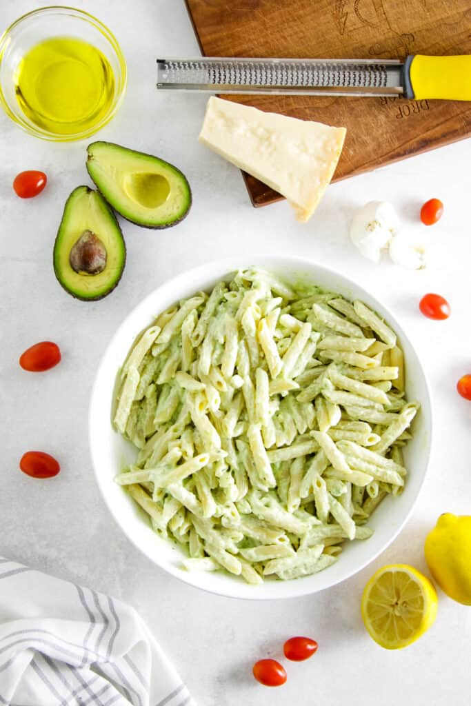 avocado pasta in large white bowl.