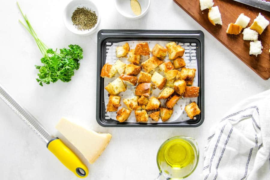 croutons cooked on air fryer tray.