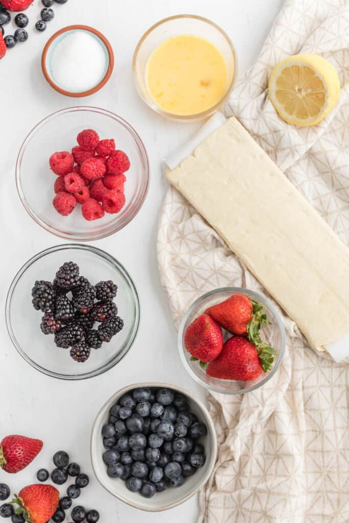 mixed berry turnover ingredients in bowls.