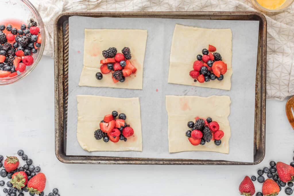 berries on puff pastry on tray.