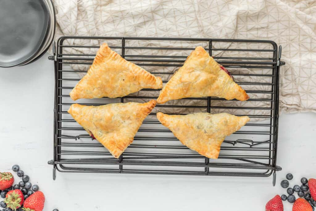 cooked turnovers on tray.