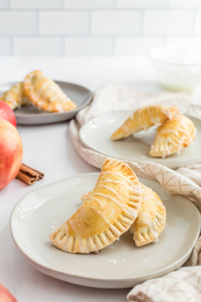 Apple Pie Turnovers on white plate.