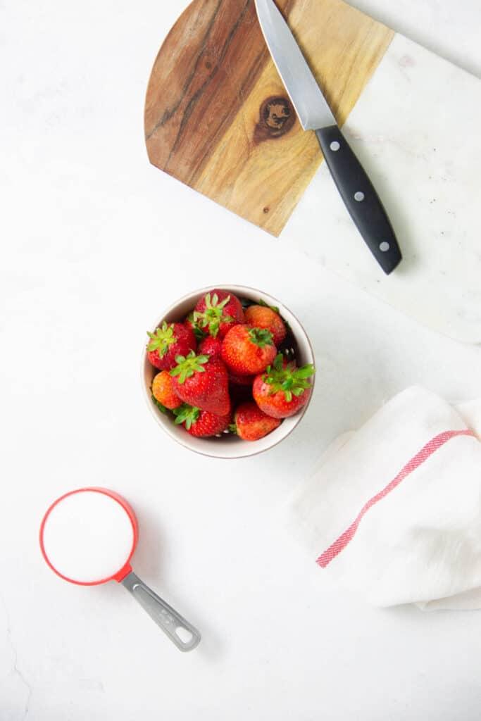 Easy Strawberry Sauce Recipe ingredients on white blackground.