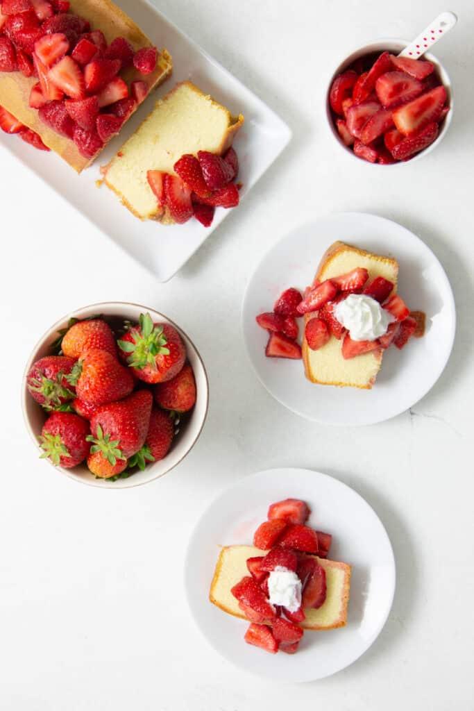 Easy Strawberry Sauce Recipe on pound cake on white plates.
