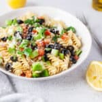 Greek Pasta Salad in white bowl.